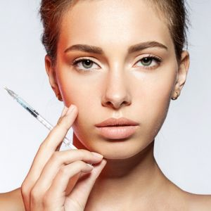 Reducing wrinkles with botox.